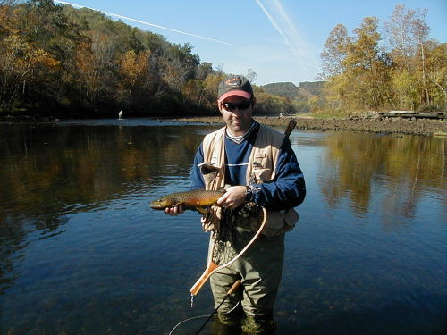 Craig Peterson with a brown trout caught below Norfork Dam.