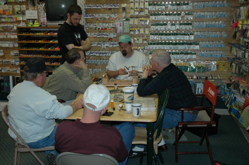 Brent Hinds is seen tying at Clear-Water Outfitters in Columbia, MO.
