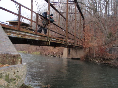 Brian Wise and Matt Tucker are scouting from the bridge overlooking Capps Creek in Jolly Mill Park.