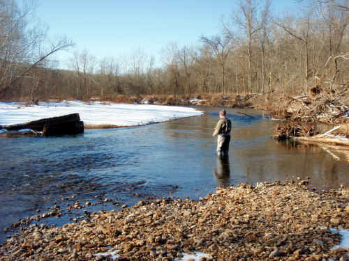 Craig Peterson is seen here fishing a section of the Little Piney after a snow fall.