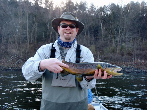Brian Greer on the White River with a nice high water brown trout.