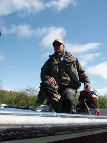 FlyFishArkansas Guide, Jim Traylor, is seen here guiding on high water on the White River.